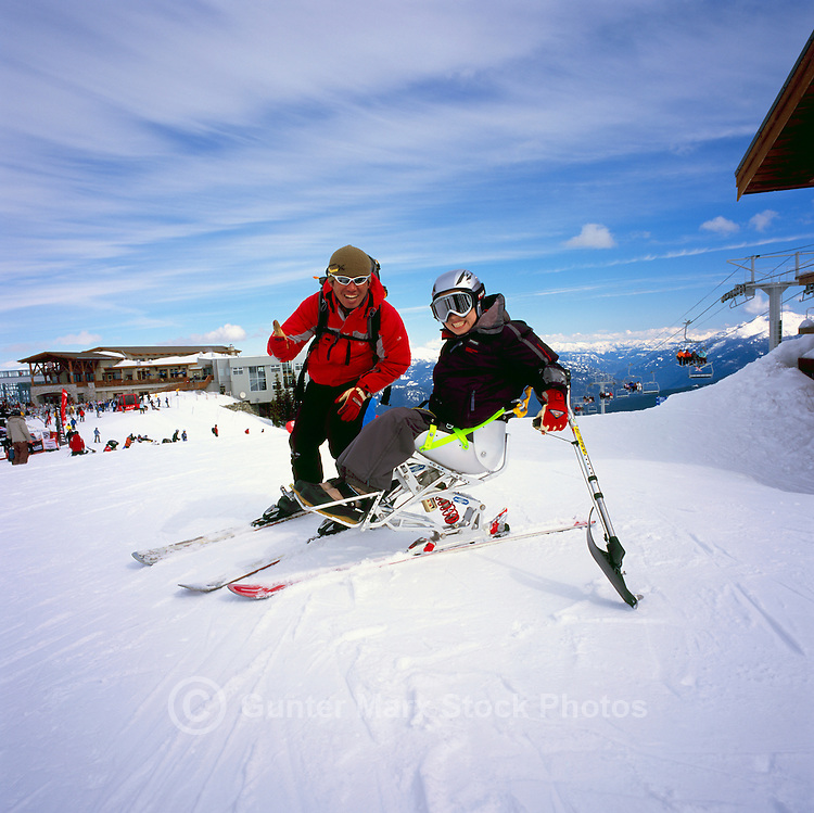Disabled Skier / Adaptive Skier sit skiing at the Roundhouse Lodge on Whistler Mountain, Whistler Ski Resort, BC, British Columbia, Canada