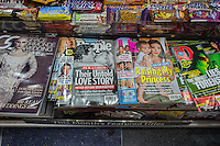 Celebrity tabloid magazines US Weekly and People displayed in a newsstand in New York on Friday, August 8, 2014. Single copy sales of magazines dropped 11.9 percent in the first three months of 2014 with celebrity magazines showing the sharpest decline. Digital replicas of print magazines grew 13 percent.  (© Richard B. Levine)