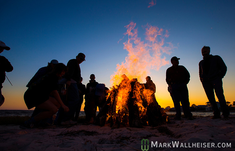 Festival goers burn their regrets in the fire at the 2017 Wind Ceremony at Shell Point Beach in the Wakulla County panhandle of Florida put on by the Shell Point Sailboard Club.