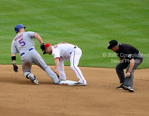 New York Mets third baseman David Wright (5) beats the tag of Washington Nationals second baseman Danny Espinosa (1) for a double in the first inning at Nationals Park in Washington, D.C. on Wednesday, July 18, 2012..Credit: Ron Sachs / CNP.(RESTRICTION: NO New York or New Jersey Newspapers or newspapers within a 75 mile radius of New York City)