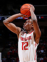 Ohio State Buckeyes forward Sam Thompson (12) shoots from three-point range during the first half of the NCAA men's basketball game between the Ohio State Buckeyes and the Minnesota Golden Gophers at Value City Arena in Columbus, Ohio, on Saturday, Feb. 22, 2014. At the end of the first half, Minnesota led Ohio State, 28-18. (Columbus Dispatch/Sam Greene)