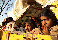 "Young girls arrrive with their family members in a bullock cart at the Yellamma Jatre (fesival) in Saundatti, India. As part of Yellamma custom, during the full moon festival which happens once a year, young girls from impoverished lower caste families are ""married"" to the goddess Yellamma to appease her. Once they are married to Yellamma, they are regarded as servants to the goddess and must perfrom temple duties as well as satisfy the sexual needs of the priests and other men.  They may no longer marry a mortal and often end up being sold by unscrupulous priests to pimps who take them to work in the red-light districts of India's urban areas. Girls with matted hair, bad skin or disabilities like blindness are most likely to be chosen as Devadasis as these qualitites are considered Yellamma's calling card."