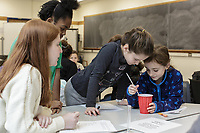 From left: Gretchen Karnowski and Rosario Manson, both 9, collaborate on an experiment as others watch during a Duke FEMMES STEM mentoring program at Duke University in Durham, North Carolina, Saturday, February 9, 2019  (Justin Cook)
