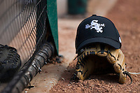 A Bristol Sox cap sits on top of a glove just outside the dugout at DeVault Memorial Stadium June 26, 2009 in Bristol, Virginia. (Photo by Brian Westerholt / Four Seam Images)