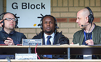 Marcus Bean of Wycombe Wanderers commentates for local radio as he starts a 3 match ban during the Sky Bet League 2 match between Wycombe Wanderers and Mansfield Town at Adams Park, High Wycombe, England on 25 March 2016. Photo by Andy Rowland.