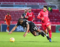 Lincoln City's John Akinde is fouled by Swindon Town's Keshi Anderson<br /> <br /> Photographer Andrew Vaughan/CameraSport<br /> <br /> The EFL Sky Bet League Two - Swindon Town v Lincoln City - Saturday 12th January 2019 - County Ground - Swindon<br /> <br /> World Copyright &copy; 2019 CameraSport. All rights reserved. 43 Linden Ave. Countesthorpe. Leicester. England. LE8 5PG - Tel: +44 (0) 116 277 4147 - admin@camerasport.com - www.camerasport.com