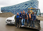Infiniti Red Bull Racing driver and Formula One triple World Champion Sebastian Vettel (3rd L) of Germany poses for a photograph with construction workers at turn two of the Olympic Park circuit against the Iceberg Skating Palace before he samples the new Russian Grand Prix venue at Sochi Olympic Park on 22 April 2013 in Sochi, Russia. Photo by Victor Fraile / The Power of Sport Images