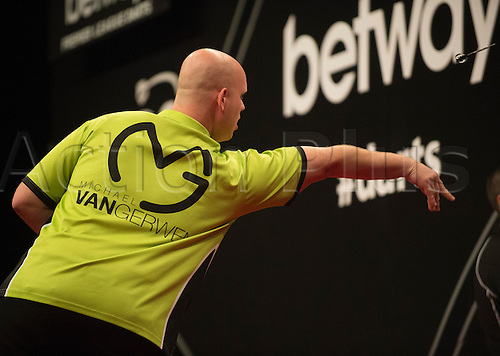 22.05.2014. London, England.  Michael van Gerwen in action against Gary Anderson during the Semi-Finals of the 2014 Betway Premier League Darts from The O2 Arena.