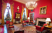 """The 2016 White House Christmas decorations are previewed for the press at the White House in Washington, DC on Tuesday, November 29, 2016. Pictured are decorations in the Red Room. The first lady's office released the following statement to describe those decorations, """"This year's holiday theme, 'The Gift of the Holidays,' reflects on not only the joy of giving and receiving, but also the true gifts of life, such as service, friends and family, education, and good health, as we celebrate the holiday season.""""<br /> Credit: Ron Sachs / CNP"""