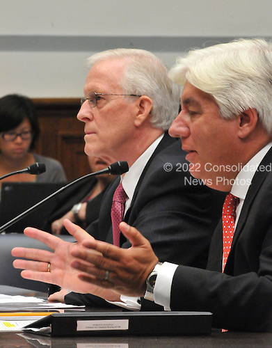 """Washington, D.C. - October 7, 2008 -- Robert B. Willumstad, former Chief Executive Officer, AIG, left, and Martin J. Sullivan, former Chief Executive Officer, AIG, right give testimony before the United States House  Committee on Oversight and Government Reform hearing on """"The Causes and Effects of the AIG Bailout"""" in the Rayburn House Office Building on Tuesday, October 7, 2008..Credit: Ron Sachs / CNP.(RESTRICTION: NO New York or New Jersey Newspapers or newspapers within a 75 mile radius of New York City)"""