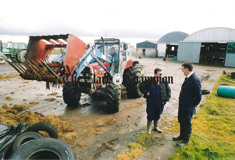 Peter McGuane (in tractor), Gerry Frawley and James O'Loughlin, farm manager, at the Teagasc research farm in Kilmaley - April 28, 2000. Photograph by Eamon Ward