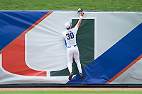 Duke Blue Devils left fielder Jimmy Herron (30) makes a catch at the top of the wall against the Virginia Cavaliers in Game Seven of the 2017 ACC Baseball Championship at Louisville Slugger Field on May 25, 2017 in Louisville, Kentucky.  The Blue Devils defeated the Cavaliers 4-3 to advance to the Semi-Finals. (Brian Westerholt/Four Seam Images)