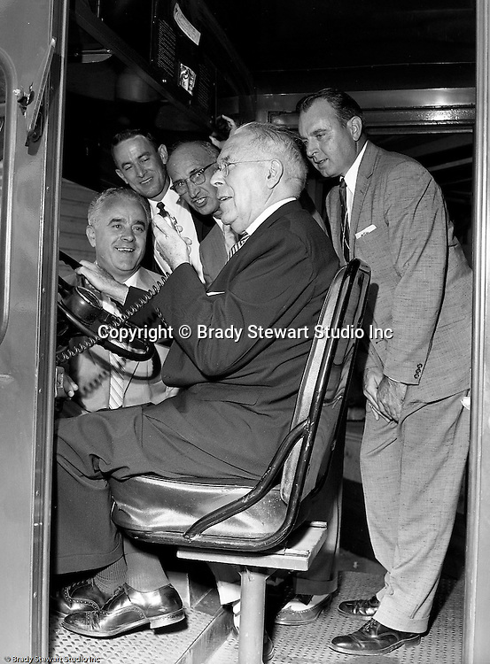 Pittsburgh PA:  View of Railway Express management trying out the new 2-way radios that were installed in all the delivery vans in 1957.  Railway Express were a group of private transportation companies throughout the Pittsburgh area. Railway Express was taken over by the state in 1964 and the emerging company was called the Port Authority of Allegheny County.