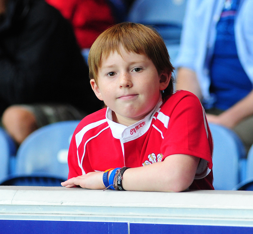A young Wales fan inside the stadium<br /> <br /> Wales Vs England - men's classification 5th - 6th place match<br /> <br /> Photographer Chris Vaughan/CameraSport<br /> <br /> 20th Commonwealth Games - Day 4 - Sunday 27th July 2014 - Rugby Sevens - Ibrox Stadium - Glasgow - UK<br /> <br /> &copy; CameraSport - 43 Linden Ave. Countesthorpe. Leicester. England. LE8 5PG - Tel: +44 (0) 116 277 4147 - admin@camerasport.com - www.camerasport.com
