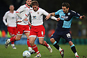 Stacy Long of Stevenage holds off Matt Bloomfield of Wycombe. - Wycombe Wanderers v Stevenage - Adams Park, High Wycombe - 31st December 2011  .© Kevin Coleman 2011