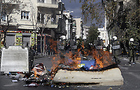 Pictured: Riot police as seen through flames  Friday 12 February 2016<br />Re: Violent clashes between farmers and riot police outside the Ministry of Agricultural Development in Athens, Greece. The farmers travelled from Crete to protest against pension and welfrae reforms proposed by the Greek government,