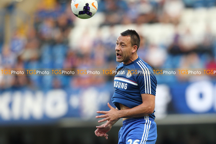 John Terry of Chelsea with a header during the warm up - Chelsea vs Aston Villa - Barclays Premier League Football at Stamford Bridge, Fulham Road, London - 21/08/13 - MANDATORY CREDIT: Simon Roe/TGSPHOTO - Self billing applies where appropriate - 0845 094 6026 - contact@tgsphoto.co.uk - NO UNPAID USE