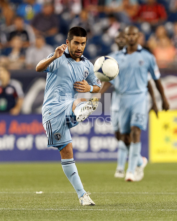 Sporting Kansas City midfielder Paulo Nagamura (6) volley pass. In a Major League Soccer (MLS) match, Sporting Kansas City defeated the New England Revolution, 1-0, at Gillette Stadium on August 4, 2012.