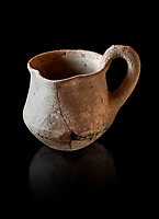 Hittite terra cotta cult side handled spouted jug. Hittite Period 1650 - 1450 BC, Ortakoy Sapinuvwa .  Çorum Archaeological Museum, Corum, Turkey. Against a black bacground.