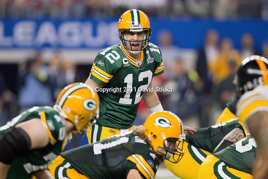 Green Bay Packers wide receiver Aaron Rodgers (12) calls an audible during Super Bowl XLV against the Pittsburgh Steelers on Sunday, February 6, 2011, in Arlington, Texas. The Packers won 31-25. (AP Photo/David Stluka)