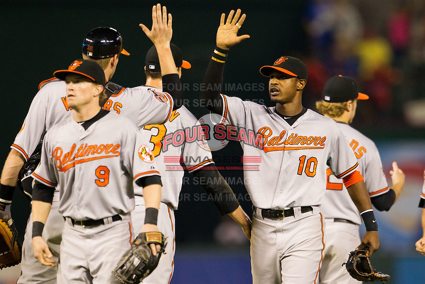 Baltimore Orioles outfielder Adam Jones #10 celebrates following the Major League Baseball game against the Texas Rangers on August 21st, 2012 at the Rangers Ballpark in Arlington, Texas. The Orioles defeated the Rangers 5-3. (Andrew Woolley/Four Seam Images)..
