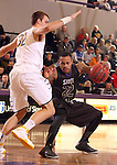 SIOUX FALLS, SD - DECEMBER 7:  Charles Ward #22 from the University of Sioux Falls tries to get by the defense of Casey Schilling #32 from Augustana in the first half of their game Saturday evening at the Stewart Center. (Photo by Dave Eggen/Inertia)