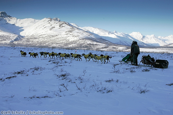 March 5, 2007   Rainy Pass checkpoint----  4-time winner Jeff King heads up Ptarmigan Valley on his way toward Rainy Pass shortly after leaving the Rainy Pass checkpoint on Puntilla Lake with the Alaska Range in the background.