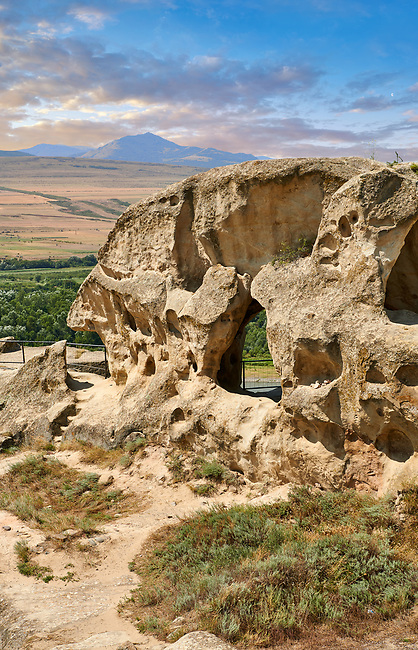 Picture & image of rock caves of Uplistsikhe (Lords Fortress) troglodyte cave city, near Gori, Shida Kartli, Georgia. UNESCO World Heritage Tentative List<br /> <br /> Inhabited from the early Iron age to the late middle ages Uplistsikhe cave city eas, during the Roman & Hellenistic period, home to around 20,000 people.
