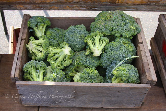 Wooden box of broccoli.