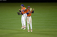 Outfielders Bo Majkowski (16), Bryce Teodosio (13), and Elijah Henderson (6), rear, of the Clemson Tigers jump and bump after a 2-0 win against the Stony Brook Seawolves on Friday, February 21, 2020, at Doug Kingsmore Stadium in Clemson, South Carolina. (Tom Priddy/Four Seam Images)