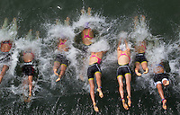 01 SEP 2013 - SARTROUVILLE, FRA - Competitors dive into the water for the start of the women's Grand Prix de Triathlon de Sartrouville in Sartrouville, France (PHOTO COPYRIGHT © 2013 NIGEL FARROW, ALL RIGHTS RESERVED)