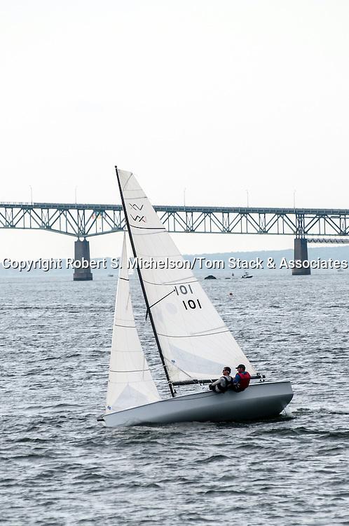 Vanguard V-15 sailboat races in front of the Jamestown Verrazzano Bridge in Newport, Rhode Island