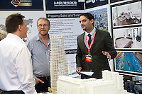 Ben Robinson of Henry Wiltshire, speaks to potential buyers at their booth at the Smart International Property Investment Expo at the Hong Kong Convention and Exhibition Centre in Hong Kong. <br /> 07-08 June, 2014<br /> <br /> Photo by Tim O'Rourke / Sinopix