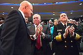 CIA Director John Brennan (C) and Director of the National Security Agency Mike Rogers applaud as Director of National Intelligence James Clapper takes his seat after introducing President Barack Obama at a ceremony marking the 10th anniversary of the formation for the Office of the Director of National Intelligence, at it's headquarters on April 24, 2015 in McLean, Virginia. <br /> Credit: Kevin Dietsch / Pool via CNP