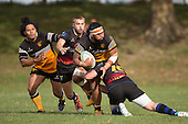 Peter Vea looks for support as he is tackled by Nathan Landsford. Counties Manukau Premier Club rugby game between Te Kauwhata and Onewhero, played at Te Kauwhata on Saturday April 16th 2016. Onewhero won the game 37 - 0 after leading 13 - 0 at Halftime. Photo by Richard Spranger.
