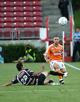 FC Pachuca defender Paul Nicolas Aguilar (22) slide tackles Houston Dynamo defender Wade Barrett (24).   Houston Dynamo beat FC Pachuca 2-0 at Robertson Stadium in Houston, TX on March 15, 2007 in the first of a two game series in the CONCACAF Champions' Cup semi-finals.