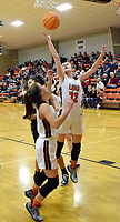 Westside Eagle Observer/MIKE ECKELS<br /> <br /> Kaylan Chilton (Lions 32) grabs a rebound during second quarter action of the Gravette-Priaire Grove varsity baseball contest in Gravette Jan 14. Chilton contributed nine points to the 55-36 Lady Lions conference victory over the Lady Tigers.
