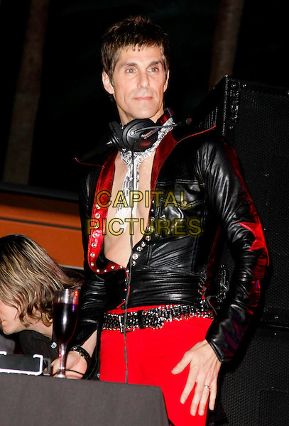 PERRY FARRELL .Slash celebrates his birthday with a special concert held at the Bare Pool Lounge in the Mirage Hotel and Casino, Las Vegas, Nevada, USA,.23 July 2008..on stage live gig concert half length black leather jacket red trousers scarf .CAP/ADM/MJT.©MJT/Admedia/Capital Pictures