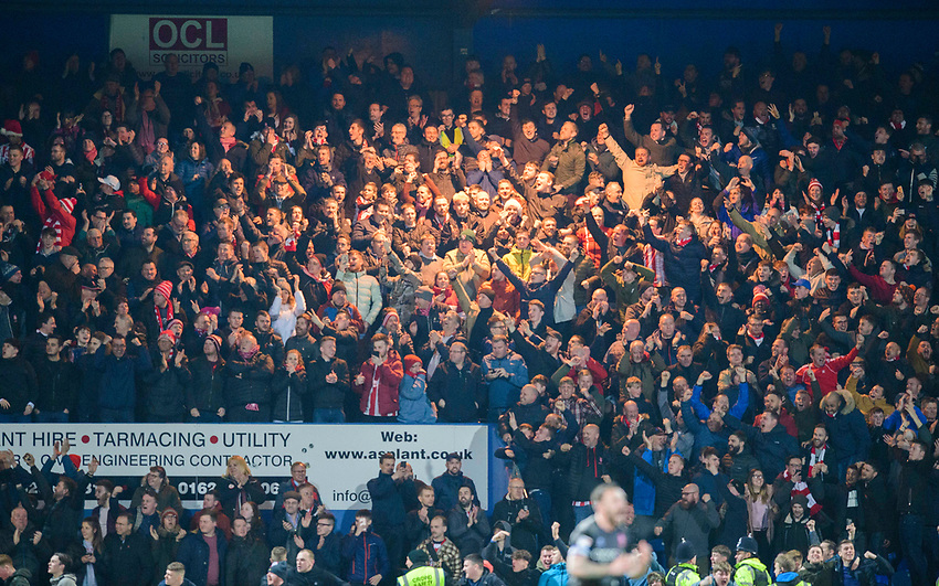 Lincoln City fans celebrate their teams goal, scored by John Akinde<br /> <br /> Photographer Chris Vaughan/CameraSport<br /> <br /> The EFL Sky Bet League Two - Mansfield Town v Lincoln City - Monday 18th March 2019 - Field Mill - Mansfield<br /> <br /> World Copyright © 2019 CameraSport. All rights reserved. 43 Linden Ave. Countesthorpe. Leicester. England. LE8 5PG - Tel: +44 (0) 116 277 4147 - admin@camerasport.com - www.camerasport.com