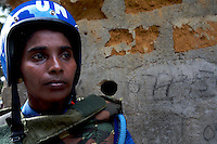 Indian female Peacekeepers from the Indian FPU ( formed police unit ) patrols while providing armed  support to the liberian national police  during a cordon and search operation in Monrovia, Liberia on Monday March 19 2007. .103 Indian police personnel  were specially selected to take part in the UNMIL peacekeeping mission in Liberia for an initial deployment of 6 months. .They are the first contingent entirely formed by women in the history of the United Nations Peacekeeping..their mission in the country is to provide fire support to the unarmed liberian security forces. In india these women distinguished themselves by operating in the most troubled areas of the country taking part in counter insurgency and crowd control special operations.