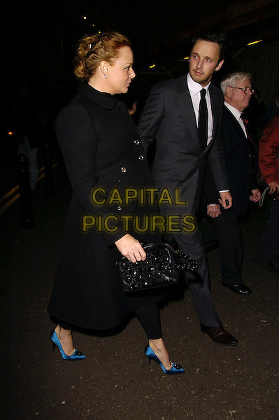 STELLA McCARTNEY & ALASDHAIR WILLIS.At the Paul McCartney Concert,.Royal Albert Hall, London, England, .November 3rd 2006..full length pregnant married husband wife blue turquoise shoes black coat bag profile side alistair.Ref: CAN.www.capitalpictures.com.sales@capitalpictures.com.©Can Nguyen/Capital Pictures