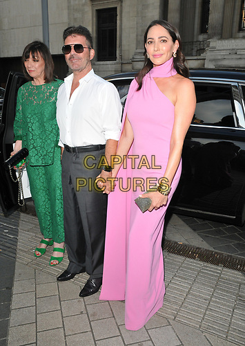 Simon Cowell and Lauren Silverman at the Syco summer party, Victoria and Albert Museum, Cromwell Road, London, England, UK, on Thursday 04th July 2019.<br /> CAP/CAN<br /> ©CAN/Capital Pictures
