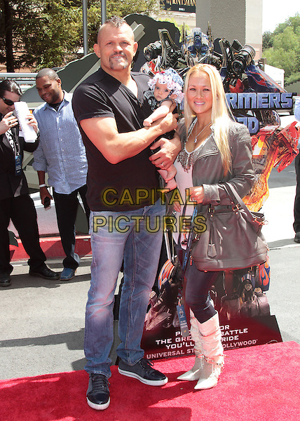 Chuck Liddell, Heidi Northcott.The World Premiere of Universal Studios Hollywood's 'Transformers: The Ride-3D' held at Universal Studios, Universal City, California, USA..May 24th, 2012.full length black t-shirt jeans denim kid child grey gray bag purse .CAP/ADM/SLP/JO.©James Orken/Starlitepics/AdMedia/Capital Pictures.