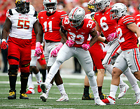 Ohio State Buckeyes linebacker Dante Booker (33) celerates his sack of Maryland Terrapins quarterback Max Bortenschlager (18) in the first half of their game at Ohio Stadium in Columbus, Ohio on October 7, 2017.   [Brooke LaValley / Dispatch]