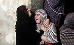 Relatives of four Palestinian children from the Baker family, whom medics said were killed by a shell fired by an Israeli naval gunboat, mourn during their funeral in Gaza City July 16, 2014. Four Palestinian children were killed and one was critically wounded on a Gaza beach on Wednesday by the shell fired by the Israeli naval gunboat, a Palestinian health official said. Asked about the incident, an Israeli military spokesman in Tel Aviv said he was checking the report. Gaza health officials said 207 Palestinians, most of them civilians, had been killed in air and naval barrages, in the worst flareup of Israeli-Palestinian violence in two years. One Israeli has been killed by shelling from Gaza that has made a race to shelter a daily routine for hundreds of thousands in Israel. Photo by Ali Jadallah