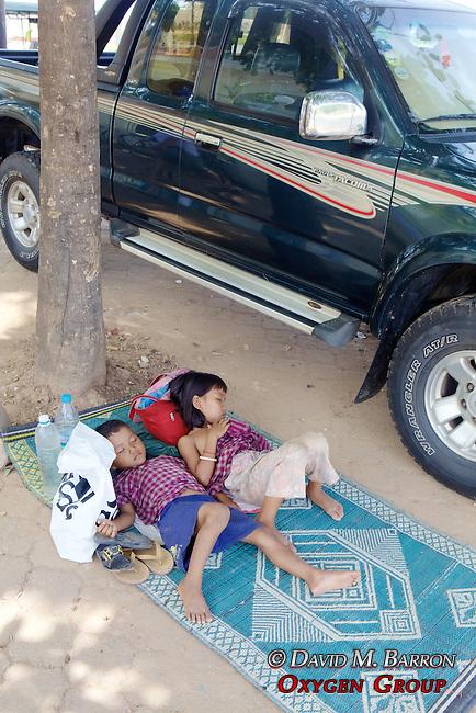 Kids Sleeping On Sidewalk