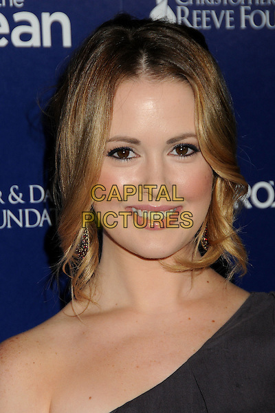 AYNSLEY BUBBICO .7th Annual Night By The Ocean Gala held at the Beverly Hilton Hotel, Beverly Hills, California, USA, .17th October 2010..portrait headshot grey gray one shoulder smiling .CAP/ADM/BP.©Byron Purvis/AdMedia/Capital Pictures.