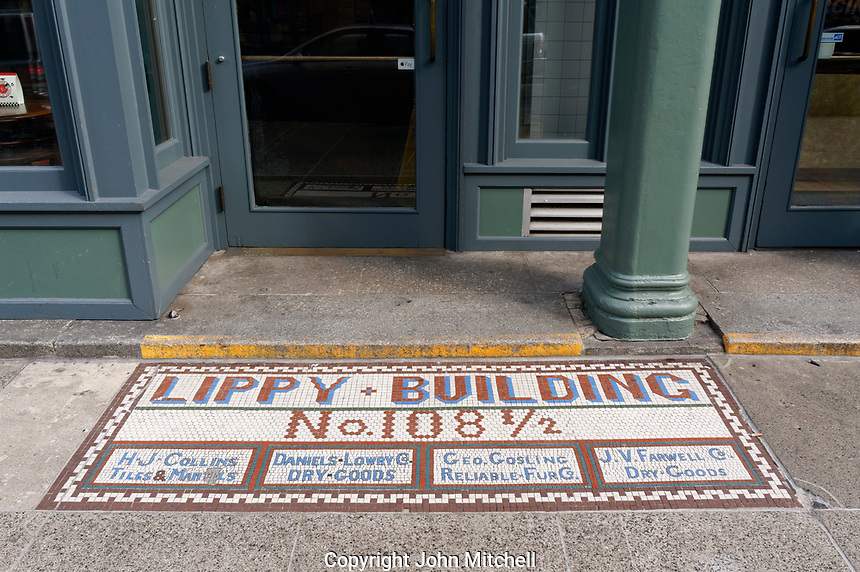 Tiled ghost sign or title sign on the sidewalk in front of the Lippy Building in the Pioneer Square neighborhood of Seattle, Washington, USA