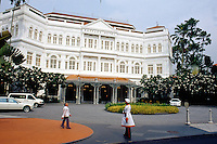 Singapore. Downtown. Town center. The Raffles Hotel on Beach Road is far more than just an expensive place to stay, more than the best-known hotel in Singapore. It's a Singapore institution, an architectural landmark that has been classified by the government as a part of Singapore cultural heritage. An indian employee is at the hotel's gate. © 2001 Didier Ruef