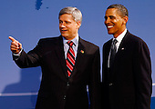 Pittsburgh, PA - September 24, 2009 -- United States President Barack Obama (R) welcomes Canadian Prime Minister Stephen Harper to the opening dinner for G-20 leaders at the Phipps Conservatory on Thursday, September 24, 2009 in Pittsburgh, Pennsylvania. Heads of state from the world's leading economic powers arrived today for the two-day G-20 summit held at the David L. Lawrence Convention Center aimed at promoting economic growth. .Credit: Win McNamee / Pool via CNP